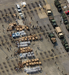 US military personnel distribute water and food to the victims of Hurricane Katrina outside the ...