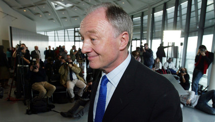 London Mayor Ken Livingstone leaves after his weekly news conference in London.