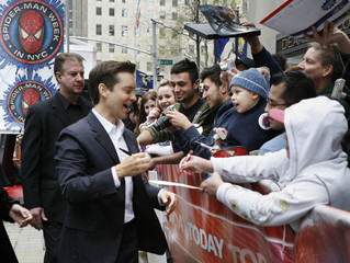 Actor Tobey Maguire is greeted by fans during an appearance on NBC's Today show in New York