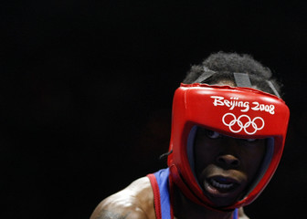 Warren of the U.S. eyes Lee of South Korea during their men's flyweight (51kg) round of 32 boxing match at the Beijing 2008 Olympic Games