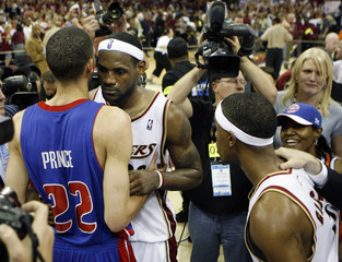 Cleveland Cavaliers' LeBron James hugs Detroit Pistons' Tayshaun Prince at the end of Game 6 of the NBA Eastern Conference Finals basketball series in Cleveland