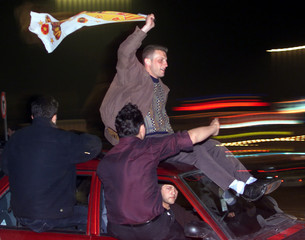 TURKISH SOCCER FANS CELEBRATE GALATASARAY'S VICTORY IN UEFA CUP.