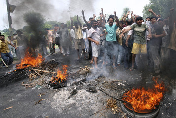 Protesters shout slogans during a demonstration in Jammu
