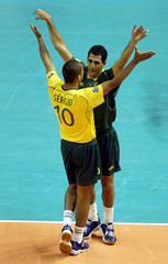 SERGIO AND MAURICIO LIMA CELEBRATE A POINT DURING VOLLEYBALL WORLDLEAGUE FINAL IN BRAZIL.