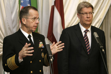 U.S. Chairman of the Joint Chiefs of Staff Michael Mullen (L) gestures as he speaks at news conference with Latvia's President Valdis Zatlers in Riga