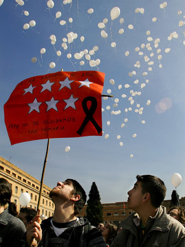 Students look into the sky after letting go balloons to mark March 11 train bombings in Madrid.