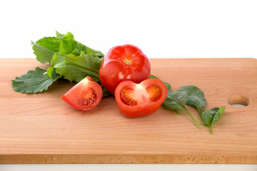 Fesh tomatoes  on the wooden background