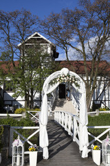 the Wedding decoration. Flowered arch  prepared for the wedding ceremony in the green garden