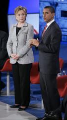 U.S. Senator Clinton listens to Senatror Obama speak during Democratic Party debate at the University of Nevada