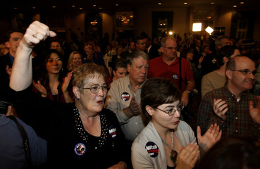 Campaign supporters cheer for U.S. Senator Mitch McConnell (R-KY) during his election night party in Louisville