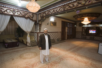 Afghan man poses for photograph at his home in Herat