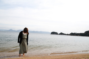 japanese young lady playing in the sea