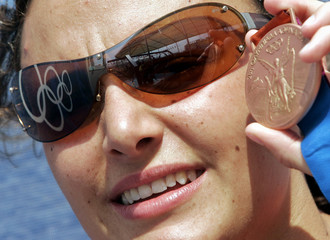 Swimmer Georgina Bardach of Argentina poses with her bronze medal at the Olympic Village.