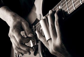 playing slide guitar