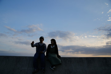 Young attractive couple at dusk