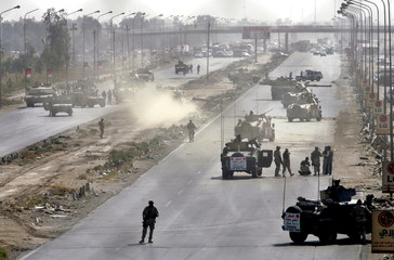 US soldiers block a main highway after roadside bomb explosion in Baghdad