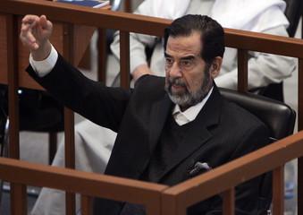 Former Iraqi leader Saddam testifies during his genocide trial in Baghdad
