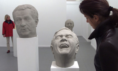 VISITORS LOOK AT SCULPTURES REPRESENTING EU COMMISSION PRESIDENT PRODI AND GERMAN CHANCELLOR ...