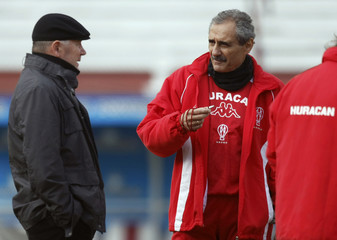 Huracan's head coach Cappa talks to the club's president Babington during training session in Buenos Aires