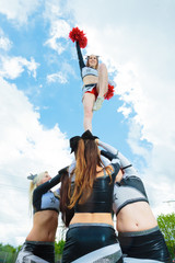Cheerleaders Making A Pyramid