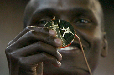 Kenya's Kipchirchir Rono holds his gold medal after winning men's 800m final at Commonwealth Games in Melbourne