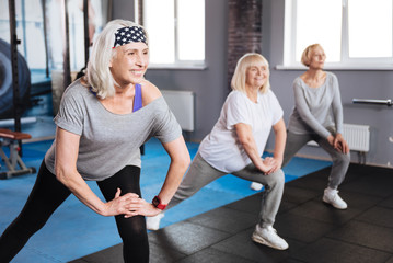 Happy elderly women training together Wall mural