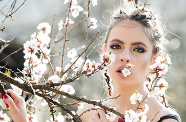 woman in beautiful spring flower blossom in garden