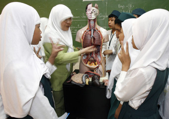 A science teacher identifies parts of the human anatomy to grade-school students at a privately-run madrasah in the eastern suburb of Manila