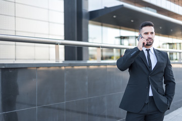 Businessman posing on the street