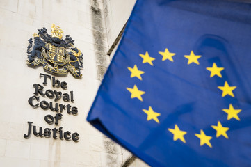 EU European Union flag flying outside the public Royal Courts of Justice building in London, United Kingdom