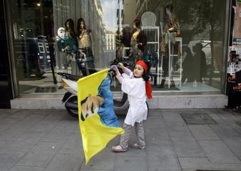 Kurdish girl carries flag with picture of imprisoned PKK leader Abdullah Ocalan in Madrid