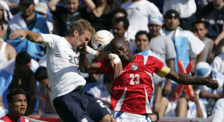 Taylor Twellman of the U.S. and Panama's Felipe Baloy battle to head the ball in Foxboro