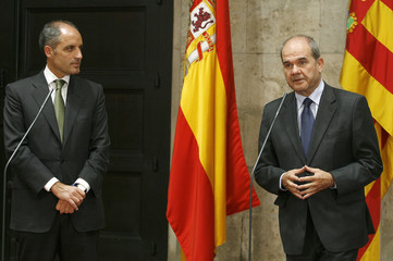 Spain's DPM and Regional Cooperation Minister Manuel Chaves speaks to the media during a news conference next to Valencia's Francisco Camps in Valencia