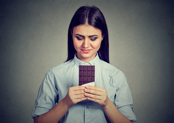 woman tired of diet restrictions craving sweets chocolate bar