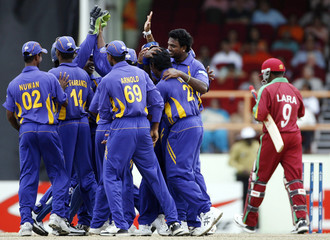 Sri Lanka players celebrate the dismissal of West Indies' captain Brian Lara during their World Cup cricket Super Eights match in Georgetown