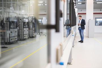 Man standing in factory shop floor