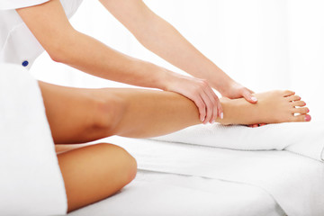 A picture of woman having leg therapy