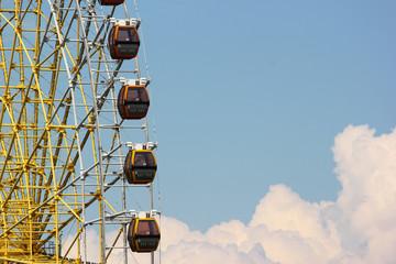Ferris wheel cabins on blue sky background at Mtatsminda Park in Tbilisi, Georgia