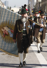 A man in traditional Bavarian clothes marches during the traditional Oktoberfest parade in Munich
