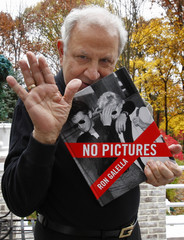 """Celebrity photographer Ron Galella holds copy of his new book """"No Pictures"""" at his home in New Jersey"""