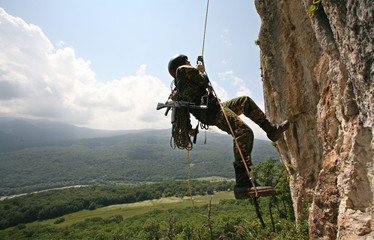 Russian member of a special unit undergoes training in the mountainous Northern Caucasus region