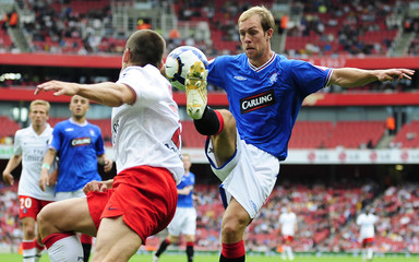 Rangers's Whitaker challenges Paris Saint-Germain's Rothern during their Emirates Cup soccer match in London