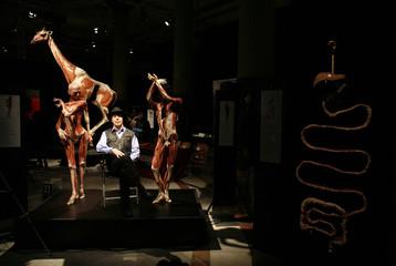 German anatomy professor Gunther von Hagens poses among plastinated human specimens in Seville