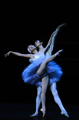 Ballet dancers perform during a dress rehearsal for a new production of Swan Lake in London