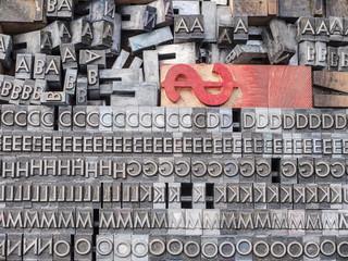 Metal type blocks for old printing press.