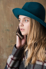 girl in hat with phone