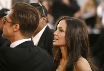 Actors Brad Pitt and Angelina Jolie arrive at the 66th annual Golden Globe awards in Beverly Hills, California