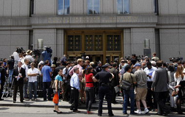 Media pack the sidewalks for the sentencing hearing for convicted swindler Madoff outside the courthouse in lower Manhattan