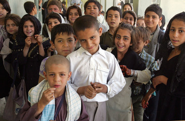 Pashtun students gather together during recess at a coeducational school in Kandahar.