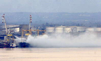 WHITE CHLORINE CLOUD FROM 'DENEB' CARGO FERTILIZER FIRE IN FRENCH PORT.